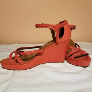 Coral colored wedge sandals.